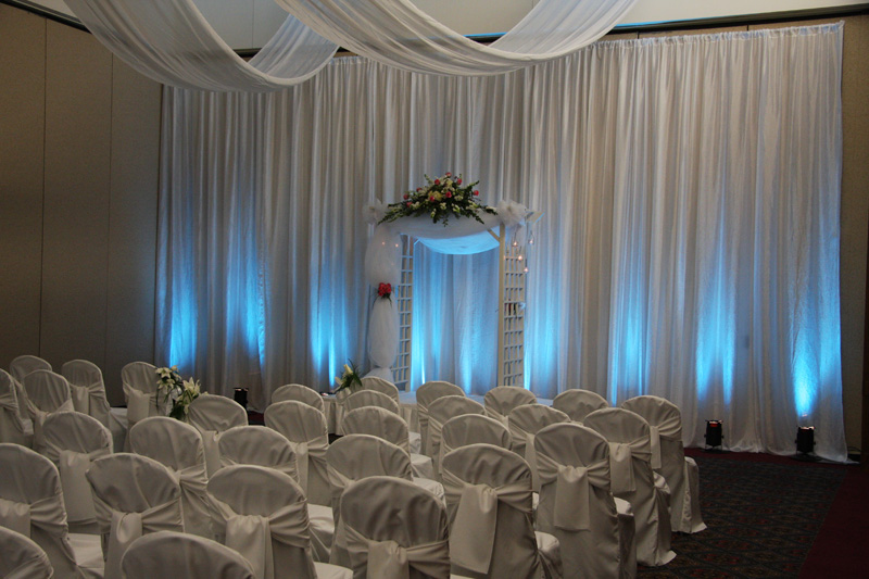 the oasis indoor ceremony wall drape uplighting ceiling drape cj
